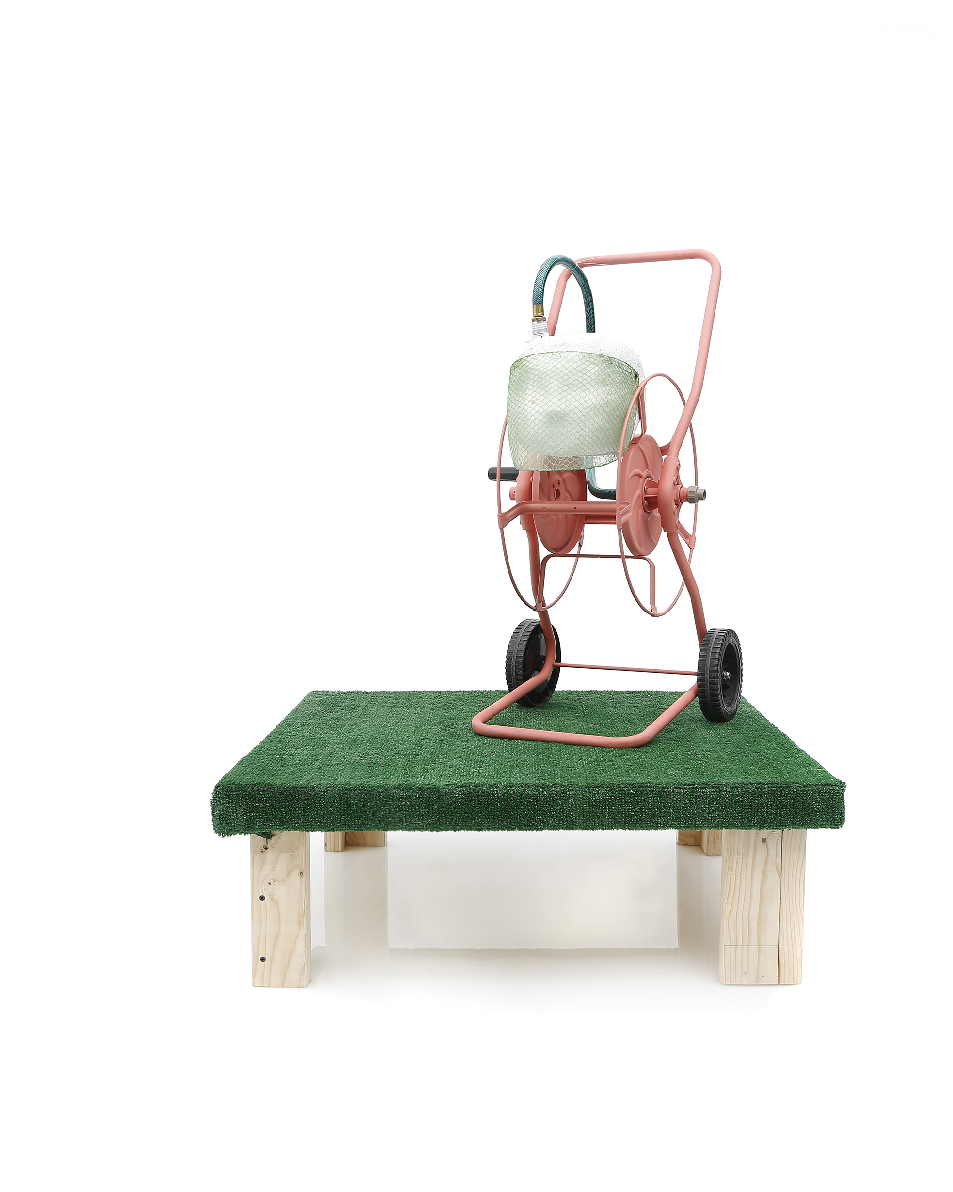 YES Machine, 2017, Hose reel, face shield, plastic mesh, foam, aqua resin, artificial grass, wood, paint