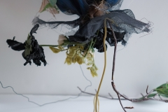 Thingamabob #3. 2014. Mesh, plastic bag, plastic flowers, styrofoam, electrical plug, lightbulb, wire.