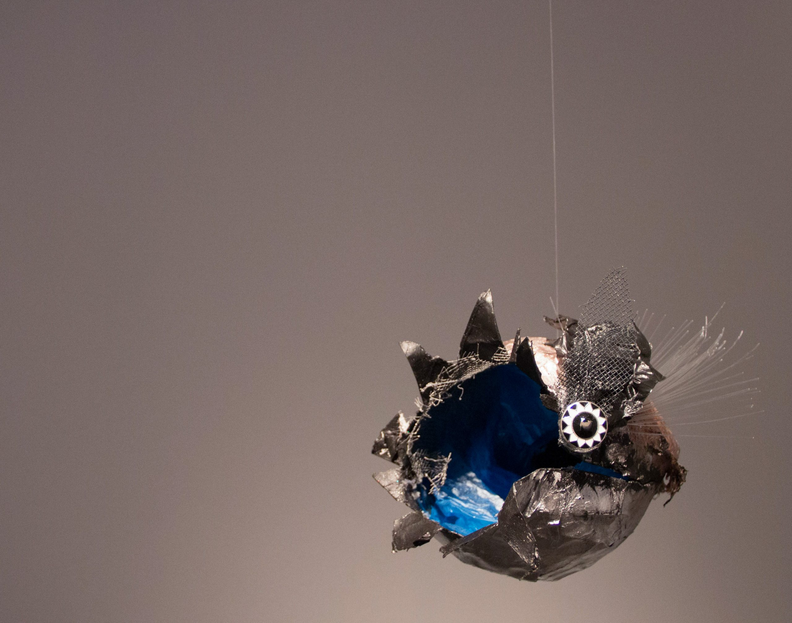 "thingamabob #2, 2014. Paper, plastic bags, wire, button, monofilament, wire mesh, spray paint, acrylic paint. Approx. 7"" x 8"" x 6."